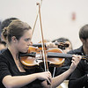Concert mistress Michelle Phillips, 18, Mtn. Range, plays during the performance of the the High School Symphonic Orchestra for the Adams 12 Five Stars Schools Orchestra Festival at Legacy High School on Saturday.<br /> For more photos please see broomfieldenterprise.com.<br /> December 3, 2011<br /> staff photo/ David R. Jennings