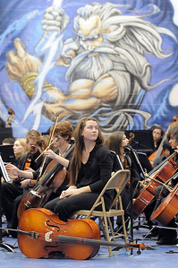 Cellist Gianna Olson, 18, Mtn. Range, waits to perform with the High School Symphonic Orchestra for the Adams 12 Five Stars Schools Orchestra Festival at Legacy High School on Saturday. For more photos please see broomfieldenterprise.com. December 3, 2011 staff photo/ David R. Jennings