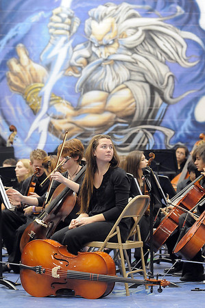 Cellist Gianna Olson, 18, Mtn. Range, waits to perform with the High School Symphonic Orchestra for the Adams 12 Five Stars Schools Orchestra Festival at Legacy High School on Saturday.<br /> For more photos please see broomfieldenterprise.com.<br /> December 3, 2011<br /> staff photo/ David R. Jennings