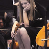 A violist with the High School Concert orchestra listens to other orchestras perform during the Adams 12 Five Stars Schools Orchestra Festival at Legacy High School on Saturday.<br /> For more photos please see broomfieldenterprise.com.<br /> December 3, 2011<br /> staff photo/ David R. Jennings