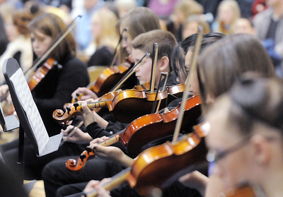 The violin section of the High School Concert Orchestra perform during the Adams 12 Five Stars Schools Orchestra Festival at Legacy High School on Saturday. For more photos please see broomfieldenterprise.com. December 3, 2011 staff photo/ David R. Jennings