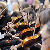 The violin section of the High School Concert Orchestra perform during the Adams 12 Five Stars Schools Orchestra Festival at Legacy High School on Saturday.<br /> For more photos please see broomfieldenterprise.com.<br /> December 3, 2011<br /> staff photo/ David R. Jennings
