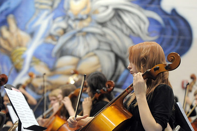 Cellists in the High School Symphonic Orchestra perform with Legacy's mural of Zeus in the back ground during the Adams 12 Five Stars Schools Orchestra Festival at Legacy High School on Saturday. For more photos please see broomfieldenterprise.com. December 3, 2011 staff photo/ David R. Jennings