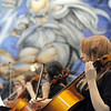 Cellists in the High School Symphonic Orchestra perform with Legacy's mural of Zeus in the back ground during the Adams 12 Five Stars Schools Orchestra Festival at Legacy High School on Saturday.<br /> For more photos please see broomfieldenterprise.com.<br /> December 3, 2011<br /> staff photo/ David R. Jennings