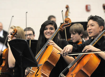 Members of the High School Concert Orchestra smile after performing in the combined  high school and middle school orchestras playing Can-Can duringthe for the Adams 12 Five Stars Schools Orchestra Festival at Legacy High School on Saturday. For more photos please see broomfieldenterprise.com. December 3, 2011 staff photo/ David R. Jennings