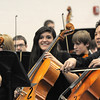 Members of the High School Concert Orchestra smile after performing in the combined  high school and middle school orchestras playing Can-Can duringthe for the Adams 12 Five Stars Schools Orchestra Festival at Legacy High School on Saturday.<br /> For more photos please see broomfieldenterprise.com.<br /> December 3, 2011<br /> staff photo/ David R. Jennings