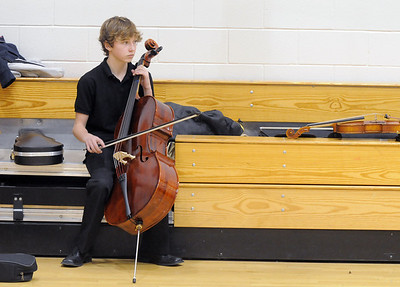 Cellist jack Helfrich, 14, Mountain Range, waits in the small gym before performing in the Adams 12 Five Stars Schools Orchestra Festival at Legacy High School on Saturday. For more photos please see broomfieldenterprise.com. December 3, 2011 staff photo/ David R. Jennings