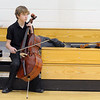 Cellist jack Helfrich, 14, Mountain Range, waits in the small gym before performing in the Adams 12 Five Stars Schools Orchestra Festival at Legacy High School on Saturday.<br /> For more photos please see broomfieldenterprise.com.<br /> December 3, 2011<br /> staff photo/ David R. Jennings