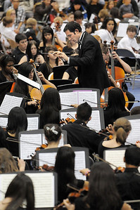 Mike Jacobetz conducts the High School Concert Orchestra for the Adams 12 Five Stars Schools Orchestra Festival at Legacy High School on Saturday. For more photos please see broomfieldenterprise.com. December 3, 2011 staff photo/ David R. Jennings