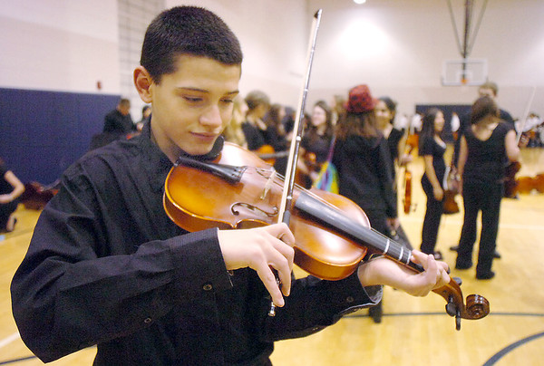 Bryson Thompson, 13, Century Middle School, plays his violin before  the Adams 12 Five Stars Schools Orchestra Festival at Legacy High School on Saturday.<br /> For more photos please see broomfieldenterprise.com.<br /> December 3, 2011<br /> staff photo/ David R. Jennings