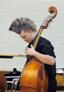 Mountain Range High double bass player Kyle Clark, 15, warms up before performing at the Adams 12 Five Stars Schools Orchestra Festival at Legacy High School on Saturday. For more photos please see broomfieldenterprise.com. December 3, 2011 staff photo/ David R. Jennings