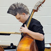 Mountain Range High double bass player Kyle Clark, 15, warms up before performing at the Adams 12 Five Stars Schools Orchestra Festival at Legacy High School on Saturday.<br /> For more photos please see broomfieldenterprise.com.<br /> December 3, 2011<br /> staff photo/ David R. Jennings