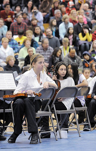 Middle School orchestra musicians listen and watch the High School Symphonic Orchestra during the Adams 12 Five Stars Schools Orchestra Festival at Legacy High School on Saturday. For more photos please see broomfieldenterprise.com. December 3, 2011 staff photo/ David R. Jennings