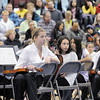Middle School orchestra musicians listen and watch the High School Symphonic Orchestra during the Adams 12 Five Stars Schools Orchestra Festival at Legacy High School on Saturday.<br /> For more photos please see broomfieldenterprise.com.<br /> December 3, 2011<br /> staff photo/ David R. Jennings
