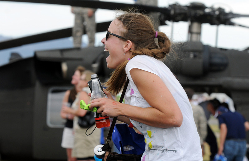 Jen Wagner, of Broomfield, reacts with excitement as an F-16 Viper flies overhead during it's performance at Saturday's Colorado Sport International Airshow at Rocky Mountain Metropolitan Airport. The airshow is in celebration of the airport's 50th anniversary.<br /> August 28, 2010<br /> staff photo/David R. Jennings
