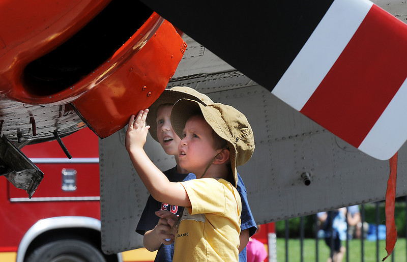 Mason Anderson, 3, right, and his brother Sawyer, 5, of Broomfield, look a T-38 training plane during Saturday's Colorado Sport International Airshow at Rocky Mountain Metropolitan Airport.<br /> August 28, 2010<br /> staff photo/David R. Jennings