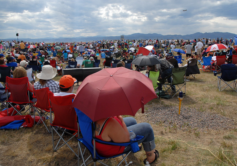 Crowds fill areas next to taxiways to watch Saturday's Colorado Sport International Airshow at Rocky Mountain Metropolitan Airport.<br /> August 28, 2010<br /> staff photo/David R. Jennings