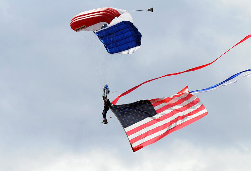 Parachutist Walt Green flies the flag to begin Saturday's Colorado Sport International Airshow at Rocky Mountain Metropolitan Airport.<br /> August 28, 2010<br /> staff photo/David R. Jennings