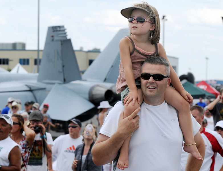 Keith Osborn and his daughter Rylee, 5, of Broomfield, watch the F-16 performance during Saturday's Colorado Sport International Airshow at Rocky Mountain Metropolitan Airport.<br /> August 28, 2010<br /> staff photo/David R. Jennings