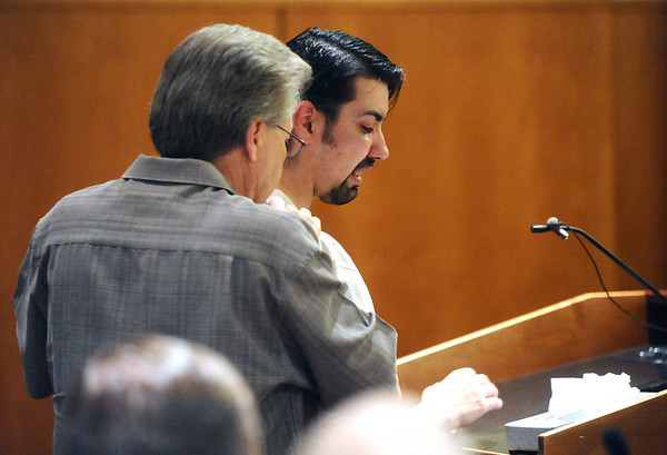 Mike Chavez, right, brother of Alexander Pacheco, is supported by his father, Gene Chavez, while he speaks during Pacheco's plea and sentencing hearing on Monday. Pacheco received 48 years in prison after pleading guilty to second-degree murder in the death of Kelsey Shannon of Broomfield. <br /> Photo by Marty Caivano/Camera/April 26, 2010