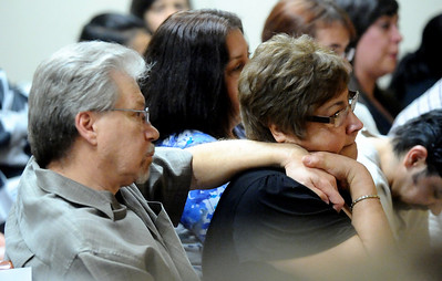 Gene and Linda Chavez, the parents of Alexander Pacheco, listen during Pacheco's plea and sentencing hearing on Monday. Pacheco received 48 years in prison after pleading guilty to second-degree murder in the death of Kelsey Shannon of Broomfield.  Photo by Marty Caivano/Camera/April 26, 2010