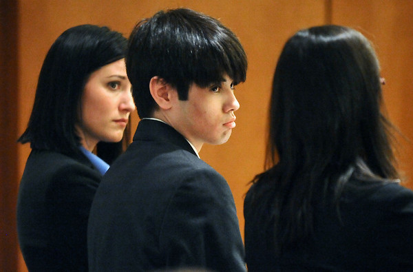 Alexander Pacheco, center, looks to his attorney, Megan Ring, for advice while entering guilty pleas during his hearing on Monday. Pacheco received 48 years in prison after pleading guilty to second-degree murder in the death of Kelsey Shannon of Broomfield. At left is defense attorney Julia Lee.<br /> Photo by Marty Caivano/Camera/April 26, 2010