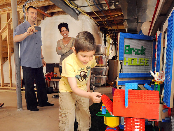 Alexander Gintchin, 6, opens the Lego mailbox of his Lego playhouse while Alexander's parents Lazar,left, and Tzvetanka watch in the basement of the family's home in the Anthem neighborhood  of Broomfield on Sunday.<br /> <br /> April 29, 2012 <br /> staff photo/ David R. Jennings