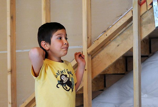 Alexander Gintchin, 6, sees his finished Lego playhouse, for the first time, made by volunteers from the Make-A-Wish Foundation of Colorado in the basement of his home in the Anthem neighborhood of Broomfield on Sunday.<br /> <br /> April 29, 2012 <br /> staff photo/ David R. Jennings