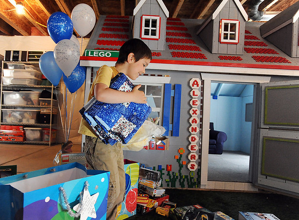 Alexander Gintchin, 6, carries a quilt for the bed in his Lego playhouse made by volunteers from the Make-A-Wish Foundation of Colorado in the basement of his home in the Anthem neighborhood of Broomfield on Sunday.<br /> <br /> April 29, 2012 <br /> staff photo/ David R. Jennings