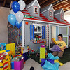 Alexander Gintchin, 6, opens gifts in front of his Lego playhouse, made  of over 7,000 Legos on a wood fram by volunteers from the Make-A-Wish Foundation of Colorado, in the basement of his home in the Anthem neighborhood of Broomfield on Sunday.<br /> <br /> <br /> April 29, 2012 <br /> staff photo/ David R. Jennings