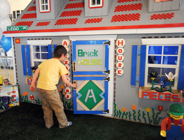 Alexander Gintchin, 6, opens the front door as begins to explore his Lego playhouse, made by volunteers from the Make-A-Wish Foundation of Colorado, in the basement of his home in the Anthem neighborhood in Broomfield of Sunday.<br /> <br /> April 29, 2012 <br /> staff photo/ David R. Jennings