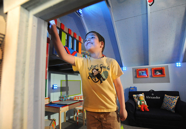 Alexander Gintchin, 6, looks at the LED lights in his Lego playhouse made by volunteers from the Make-A-Wish Foundation of Colorado in the basement of his home in the Anthem neighborhood of Broomfield on Sunday.<br /> <br /> April 29, 2012 <br /> staff photo/ David R. Jennings