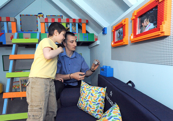 Alexander Gintchin, 6, left, with his father, Lazar, check out a Lego music box as they explore Alexander's Lego playhouse made by volunteers from the Make-A-Wish Foundation of Colorado in the basement of his home in the Anthem neighborhood of Broomfield on Sunday.<br /> <br /> <br /> April 29, 2012 <br /> staff photo/ David R. Jennings