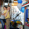 Alexander Gintchin, 6, hugs Ashlee Carey, Make-A-Wish Foundation coordinator after seeing  his Lego playhouse made by volunteers from the Make-A-Wish Foundation of Colorado in the basement of the his home in the Anthem neighborhood of Broomfield on Sunday.<br /> <br /> April 29, 2012 <br /> staff photo/ David R. Jennings