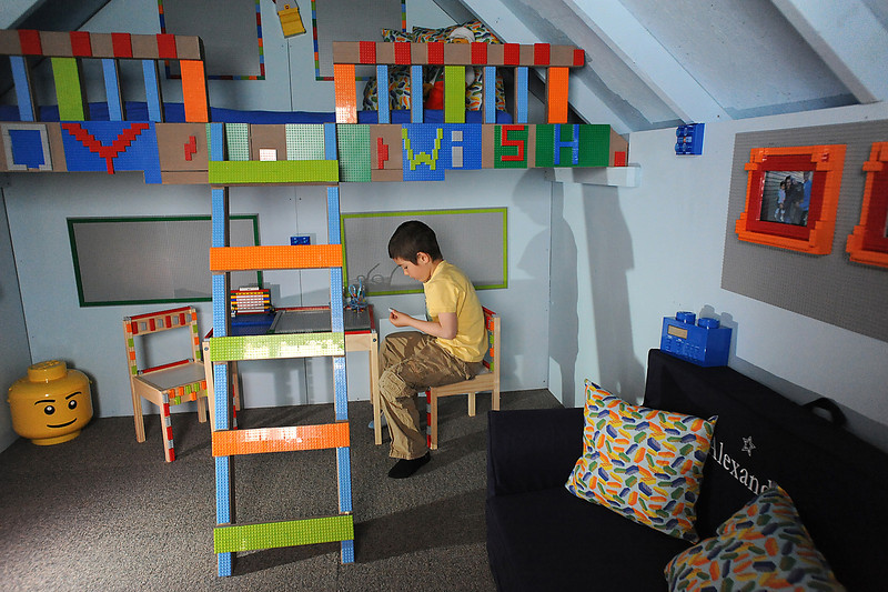 Alexander Gintchin, 6, checks out  Legos pieces on the table of his Lego playhouse, made from over 7,000 Legos on a wood fram by volunteers from the Make-A-Wish Foundation of Colorado, in the basement of his home in the Anthem neighborhood of Broomfield on Sunday.<br /> <br /> April 29, 2012 <br /> staff photo/ David R. Jennings