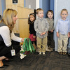 "BE1209learn05<br /> Teacher Stephanie Moore, left, goes through last minute warmup for her class to sing ""Christmas Bells"" during the Early Learning Annual Holiday Program on Saturday at the Audi. The 164 children from the morning and afternoon classes performed to a standing room only crowd.<br /> December 4, 2010<br /> staff photo/David R. Jennings"
