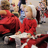 BE1209learn04<br /> Reese Sheila, 2 1/2, center, sits quietly on the floor of the green room before performing during the Early Learning Annual Holiday Program on Saturday at the Audi. The 164 children from the morning and afternoon classes performed to a standing room only crowd.<br /> December 4, 2010<br /> staff photo/David R. Jennings