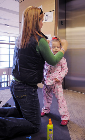 BE1209learn08<br /> Darlene Kreder does some last minute hair touch-up on her daughter Addison, 3, before for the Early Learning Annual Holiday Program on Saturday at the Audi. The 164 children from the morning and afternoon classes performed to a standing room only crowd.<br /> December 4, 2010<br /> staff photo/David R. Jennings