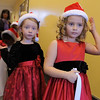 BE1209learn16<br /> Lara Lutas, 5, right, and Evelyn Peterson, 5, wait in a hallway back stage before singing during the Early Learning Annual Holiday Program on Saturday at the Audi. <br /> December 4, 2010<br /> staff photo/David R. Jennings