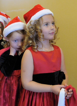 BE1209learn02<br /> Lara Lutas, 5, right, and Evelyn Peterson, 5, wait back stage before singing during the Early Learning Annual Holiday Program on Saturday at the Audi. The 164 children from the morning and afternoon classes performed to a standing room only crowds.<br /> December 4, 2010<br /> staff photo/David R. Jennings