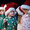 "BE1209learn03<br /> Joshua Rowan, 2 1/2, center looks back while his class sings "" I hear Santa Claus""  during the Early Learning Annual Holiday Program on Saturday at the Audi. The 164 children from the morning and afternoon classes performed to a standing room only crowd.<br /> December 4, 2010<br /> staff photo/David R. Jennings"