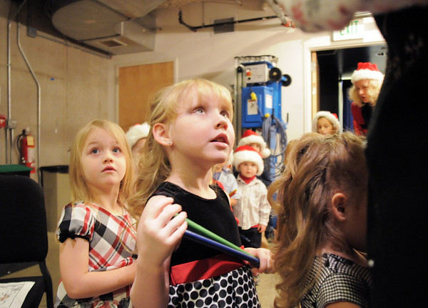BE1209learn10<br /> Brianna Kwasniewski, 4, right, and Makayla Wilkes, 4, listen to their teacher's instructions before performing in the Early Learning Annual Holiday Program on Saturday at the Audi. The 164 children from the morning and afternoon classes performed to a standing room only crowd.<br /> December 4, 2010<br /> staff photo/David R. Jennings