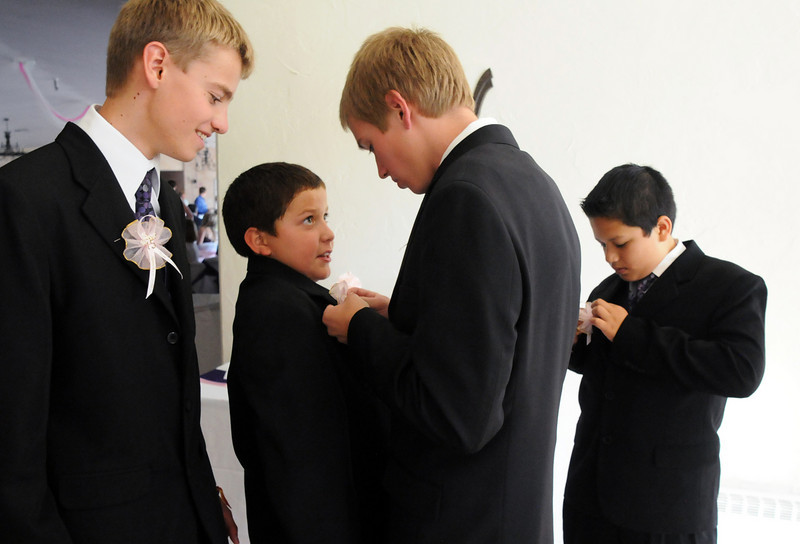The Chambelanes Blake Logan, 14, left, Nakai Milan, 10, Kollin Skattum, 14, and Francisco Martinez, 11, make final adjustments to their suits for  Antonia Ramirez's  Quinceanera ceremony<br /> <br /> September 4, 2010<br /> staff photo/David R. Jennings