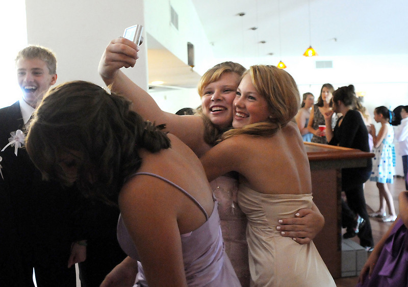 Antonia Ramirez and Scout Hill take a picture of each other at Anotonia's Quinceanera  at the Miramonte Lodge on Saturday.<br /> <br /> September 4, 2010<br /> staff photo/David R. Jennings