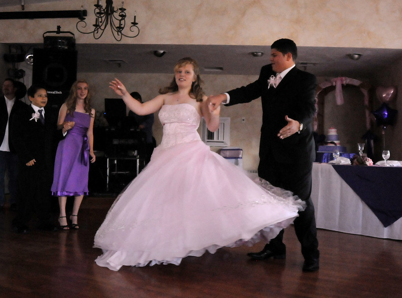 Antonia Ramirez dances the waltz with her cousin and escort Julian Bermudez, 14, during her Quinceanera ceremony at the Miramonte Lodge on Saturday.<br /> <br /> September 4, 2010<br /> staff photo/David R. Jennings