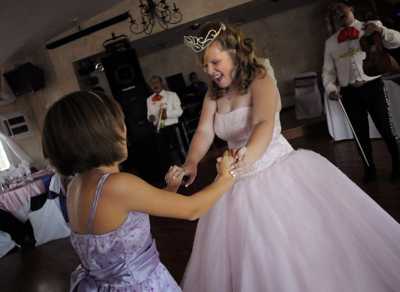 Antonia Ramirez dances with friends a family during her Quinceanera at the Miramonte Lodge.<br /> <br /> September 4, 2010<br /> staff photo/David R. Jennings