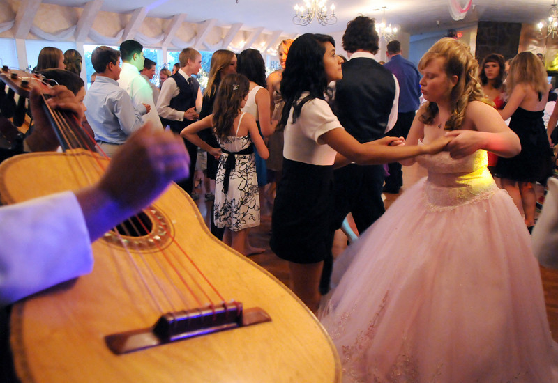 Friends and family of Antonia Ramirez dance to the music of the mariachi band during her Quinceanera ceremony at the Miramonte Lodge on Saturday.<br /> <br /> September 4, 2010<br /> staff photo/David R. Jennings