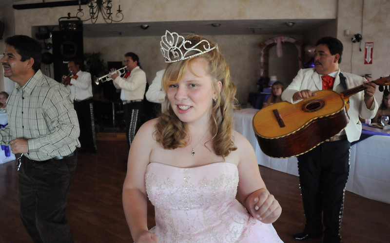Antonia Ramirez dances to the music of the mariachi band with family friend Jabir Martinez, left,  during Antonia's Quinceanera ceremony at the Miramonte Lodge on Saturday.<br /> <br /> September 4, 2010<br /> staff photo/David R. Jennings