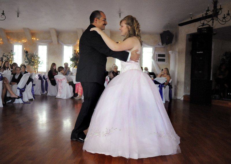 Father Daughter dance: Antonia Estes Ramirez, 15, dances with her father Alfonso Ramirez  during her Quinceanera ceremony marking Antonia's 15th birthday at the Miramonte Lodge on Saturday.<br /> <br /> September 4, 2010<br /> staff photo/David R. Jennings