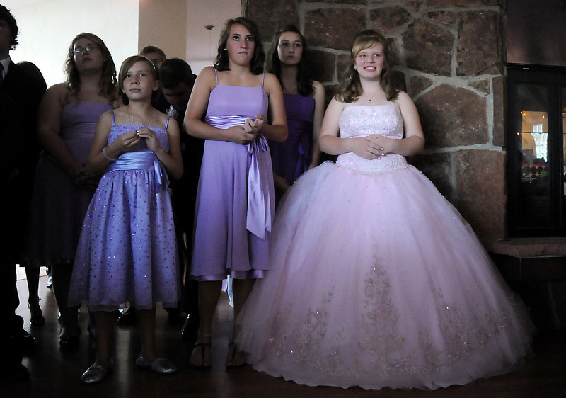 Antonia Ramirez, right, waits with her court of honor before Antonia's Quinceanera ceremony at the Miramonte Lodge on Saturday.<br /> <br /> September 4, 2010<br /> staff photo/David R. Jennings